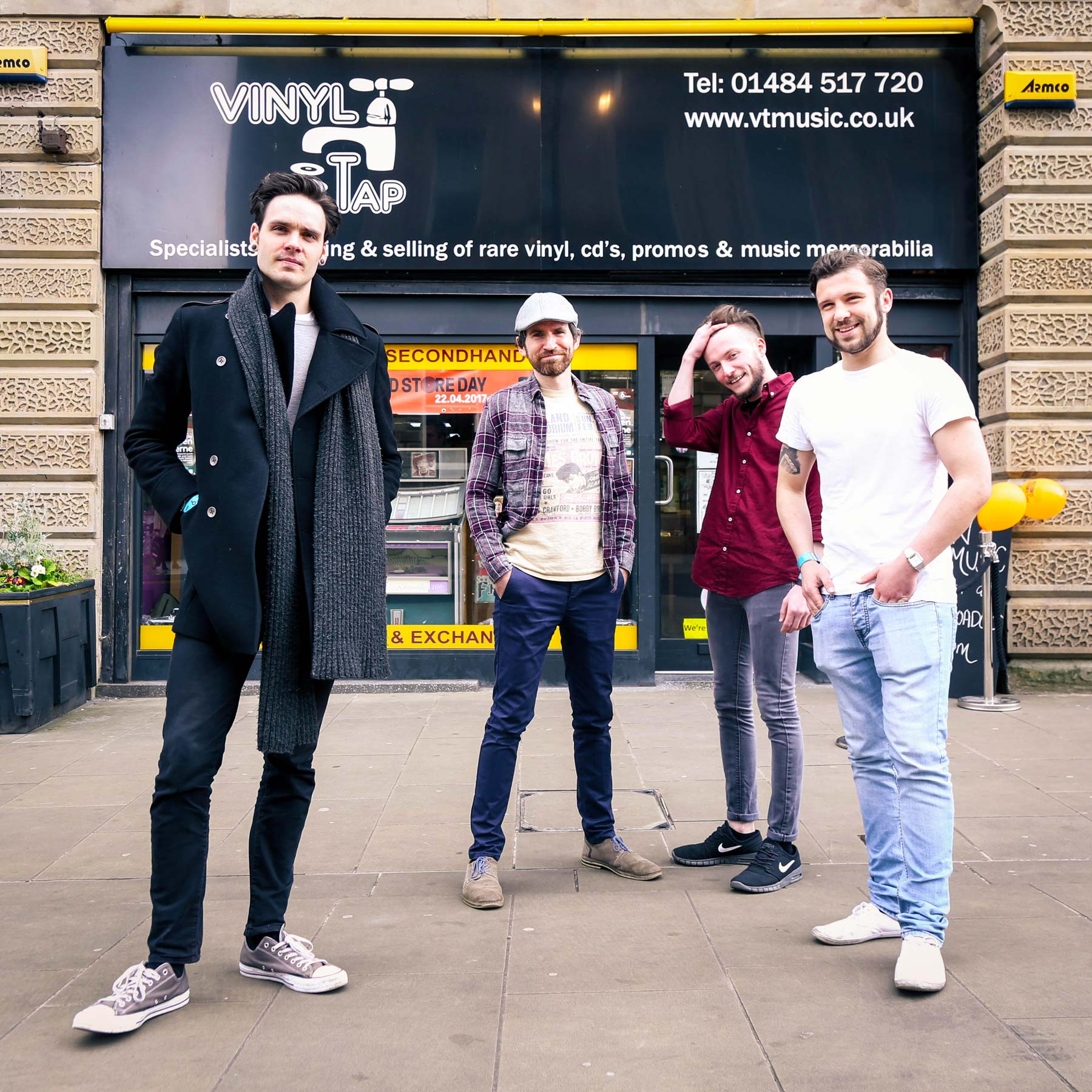 The assembled Fold band outside Vinyl Tap. Photo by Paul Husband
